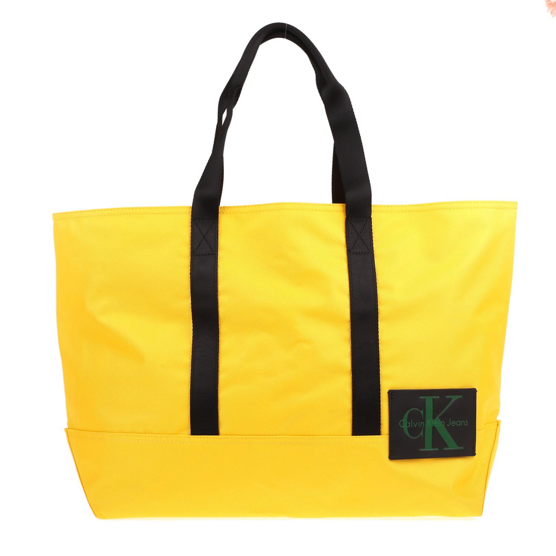 71d5dde67c CALVIN KLEIN JEANS - Unisex τσάντα χειρός SPORT ESSENTIAL CARRYALL CALVIN  KLEIN JEANS κίτρινη