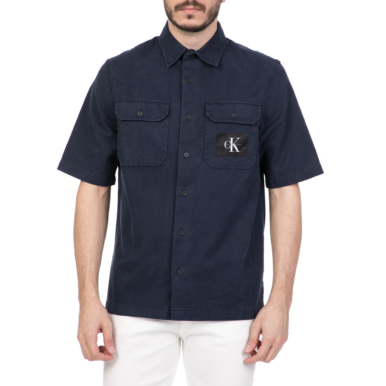 23c3ad1982 CALVIN KLEIN JEANS – Ανδρικό κοντομάνικο πουκάμισο CALVIN KLEIN JEANS μπλε  1613163.0-0018